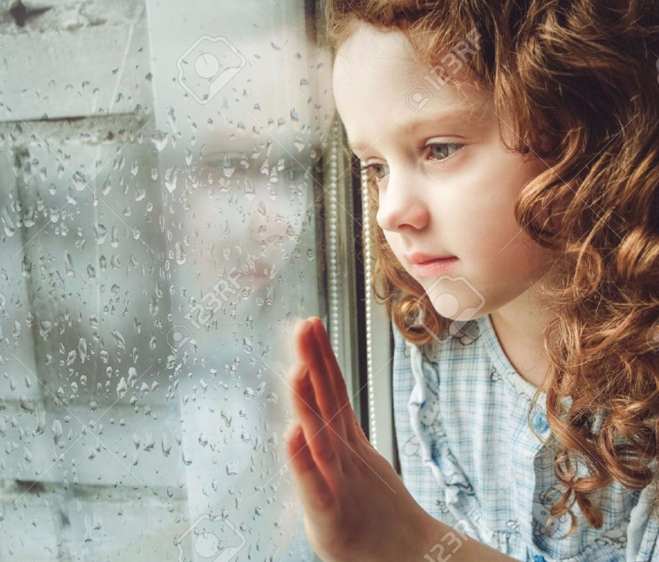 41773549-sad-child-looking-out-the-window-toning-photo-stock-photo.jpg