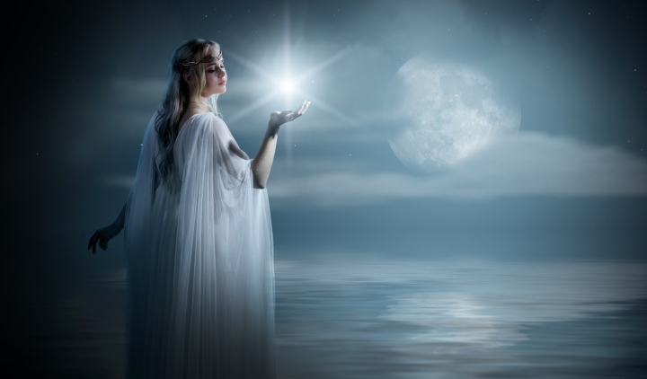 Young elven girl with star on sea coast