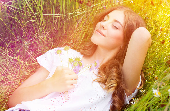 happy-young-woman-relaxing-in-nature