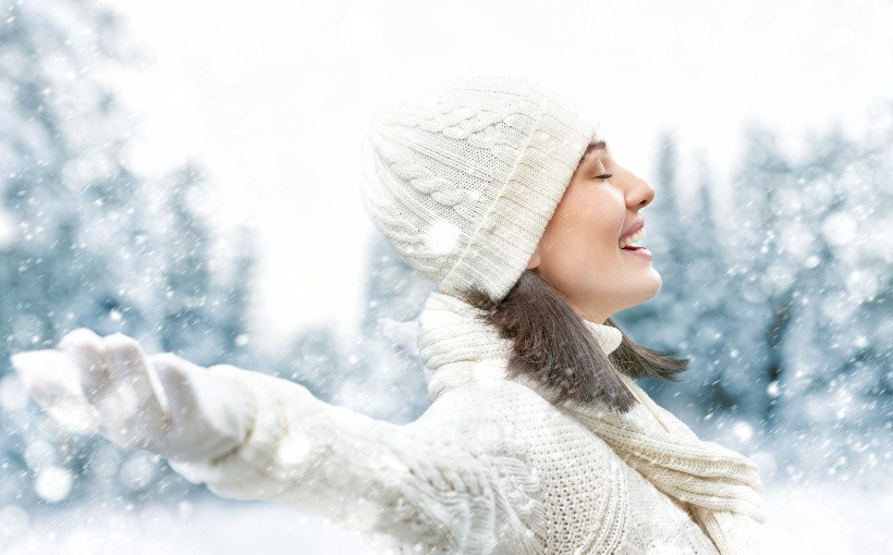 Happy young woman on a winter walk in nature.