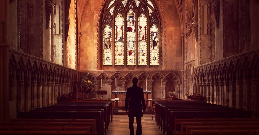 13739-man-standing-church-aisle-silhouette-pastor.1200w.tn