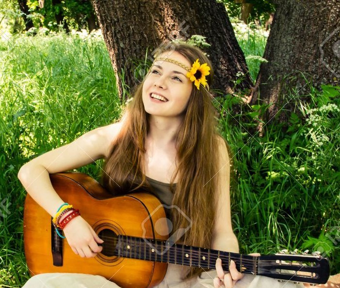 19754099-hippie-ethnic-smiling-girl-singer-with-guitar-in-the-forest
