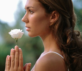 woman-with-flower-590x295