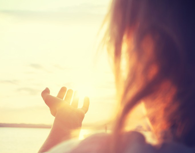 woman-grabs-sun