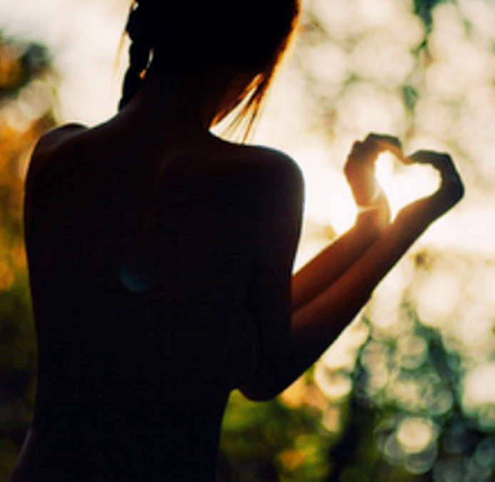 woman-making-heart-shape-with-handsning2