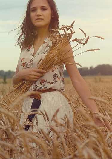 young-beautiful-romantic-woman-walking-in-a-wheat-field-hand-of-a-young-girl-touching-corn-ears-in-a-field-at-sunset-in-slowmotion-hd-1920x1080_4omonsvhoe__F0000-e1545606238693.png