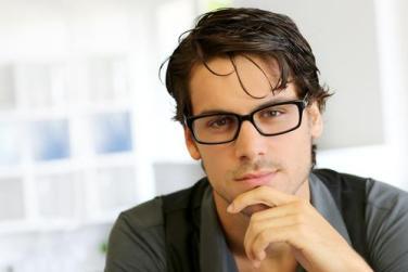 man-wearing-glasses-hand-under-chin