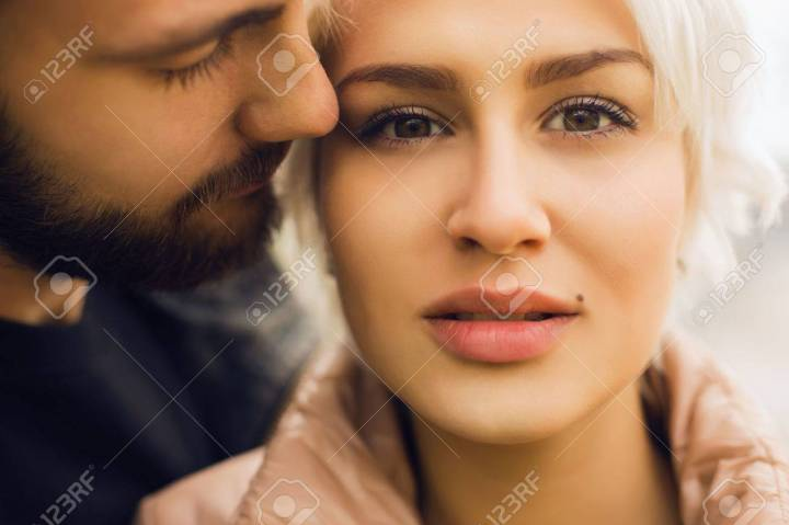 46787636-lovely-couple-romantic-beautiful-woman-and-handsome-man-bearded-boy-and-blond-girl-outdoor-together.jpg